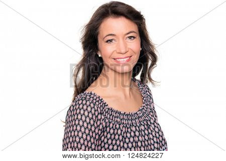 Smiling middle aged woman in front of white background