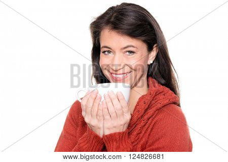 Smiling middle aged woman with a cup in front of white background