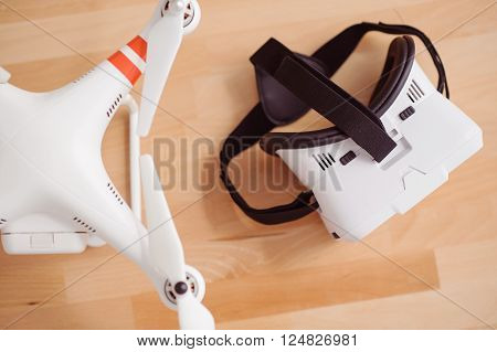Modern innovations. Top view of wireless and virtual reality device lying on the surface of table