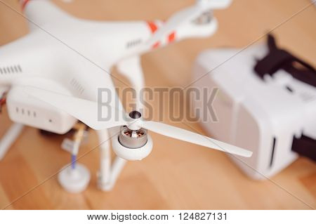 New invention, Selective focus of wireless flying device standing on the floor near virtual reality device