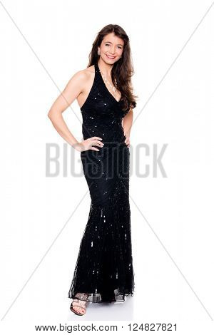 Middle aged woman with evening dress in front of white background