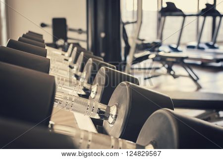 row of dumbbells in sport club, Gym interior, Vintage tone