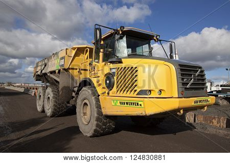 Hoogkarspel ,The netherlands - 3 March ,2016:Volvo dumper truck transporting excavated mud. This is necessary for the construction of a new viaduct and road
