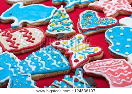 Christmas gingerbread cookies on the table covered with a red cloth