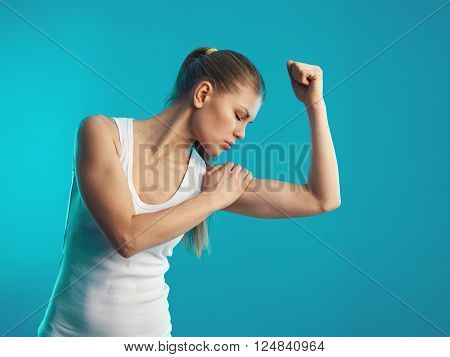 Young athletic female suffering from sprain and muscles pain. Concept of body stretch and rehabilitation.