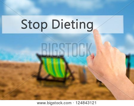 Stop Dieting - Hand Pressing A Button On Blurred Background Concept On Visual Screen.
