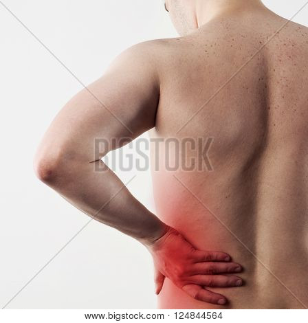 Hip pain on male body. Closeup of person body with painful left side. Concept of physiotherapy and massage.