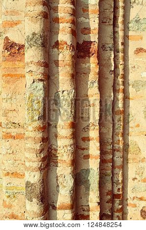 Old textured ribbed wall made of thin calcined brick known as plinfa - plinfa used in Byzantium and Ancient Rus construction. Architectural detailed background