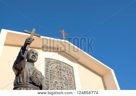 San Gabriel California USA./April 3 2016: Photo of Mission San Gabriel Arcangel with statue of Junipero Serra