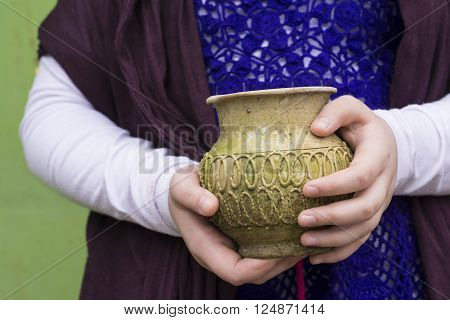 An Old Empty Weathered Vase Holden by Hands in front of Body