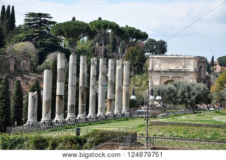 ROME ITALY - MARCH 15 2016: Tourists visiting the archaeological site of the Roman Forum (Foro Romano) near the Colosseum part of Unesco heritage in Rome Italy