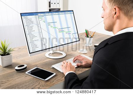 Businessman Working On Gantt Chart At Office