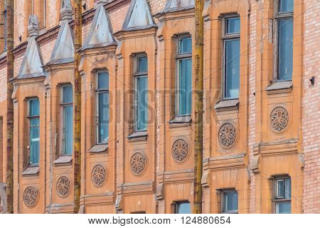 Several windows in row on facade of urban apartment building angle view St. Petersburg Russia