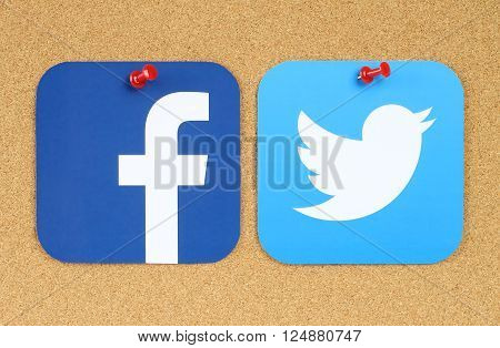 Kiev Ukraine - March 24 2015: Facebook and Twitter icons printed on paper and pinned on cork bulletin board