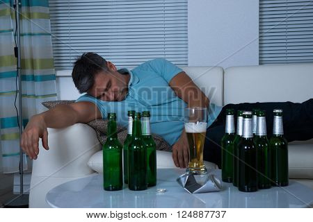 Drunken Man Taking A Nap On Sofa