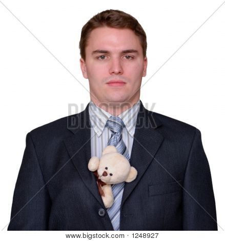 Serious Young Businessman With Teddy Bear In Suit