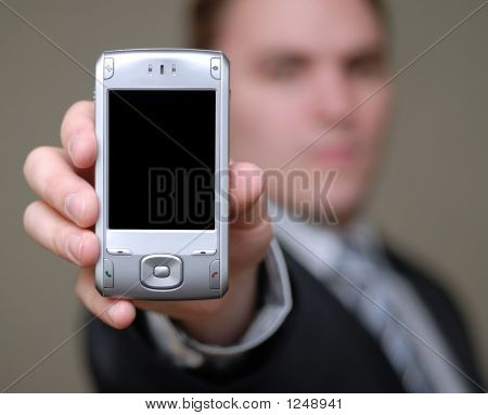 Businessman Shows Cell Phone With Shallow Depth Of Field
