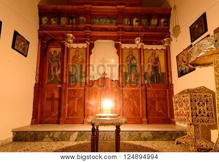 KYTHNOS, GREECE - AUGUST 14, 2014: Vigil light burning in front of the iconostasis (templon) in the chapel next to the church of Panagia Stratolatissa