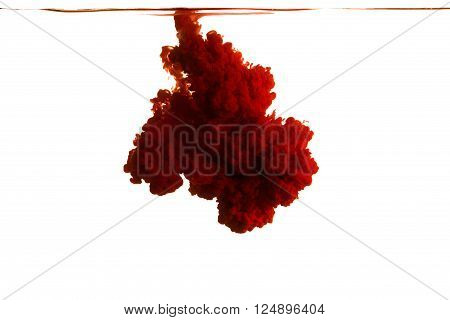 Color drop in water photographed in motion. Ink swirling in water. Cloud of ink in water isolated on white background. Colorful ink in water ink drop.