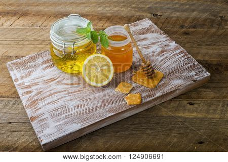 flower honey and cookies on a wooden support close up for background