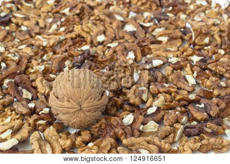 Nutmeat background and a whole walnut in it.