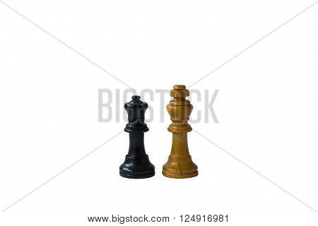 The brown chess king and the black chess queen standing next to each other.