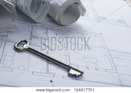 Architect worplace top view. Architectural project, blueprints, blueprint rolls and  divider compass, key, blank business card on plans. Construction background. Engineering tools. Copy space. poster