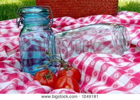Vintage Canning Jars On Antique Table Cloth