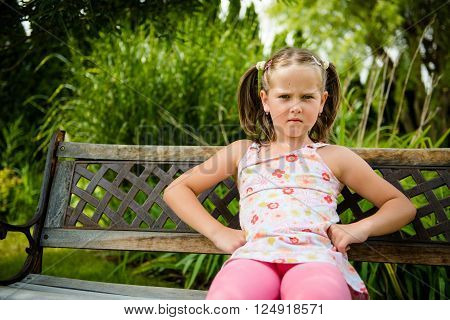 Portrait of small offended child - outoor in backyard