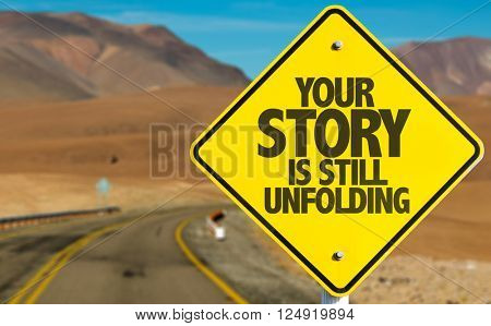 Your Story Is Still Unfolding sign on desert road