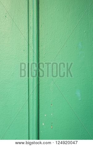 background of pipe line on wall with green painting at exterior buliding