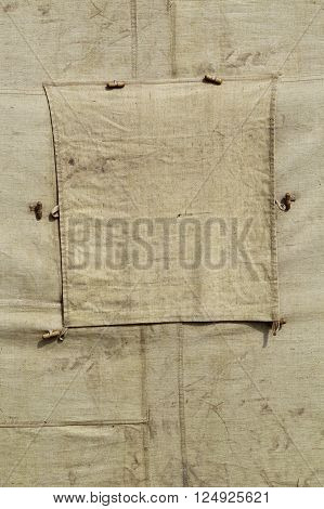 Detail of an old military tent with a window. Texture background