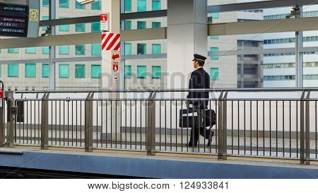 NAGOYA JAPAN - NOVEMBER 22 2015: Unidentified Japanese train conductor on a Shinkansen platform at Nagoya station