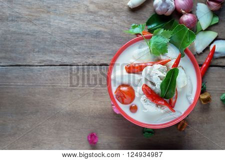 Thai style coconut milk soup with chicken in red cup (Tom Kha Gai )select focus copy space