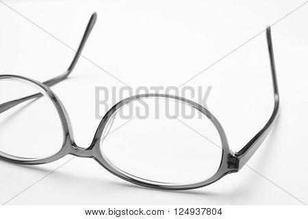 Female eyeglasses macro detail over a white background. Horizontal