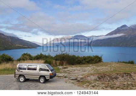 Wye Creek, New Zealand - March 27, 2015: Campervan in front of Lake Wakatipu on the South Island.