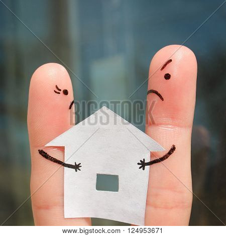Finger art of family during quarrel. Concept of man and woman can not divide house after divorce.