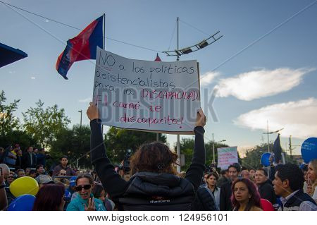 Quito, Ecuador - April 7, 2016: Group of people Holding protest signs, police and journalists during anti government protests in Shyris Avenue.
