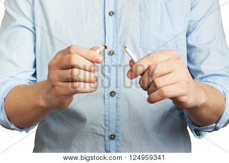 The man breaks cigarette isolated on white background. Concept protest against smoking. I quit smoking