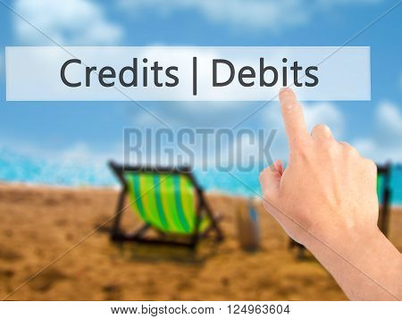 Credits  Debits - Hand Pressing A Button On Blurred Background Concept On Visual Screen.