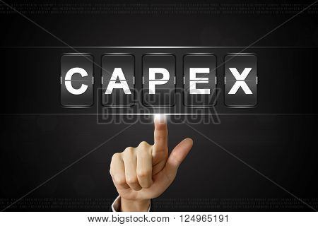 business hand pushing capex or Capital expenditure on Flipboard Display