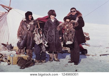 CHUKCHI PENINSULA, USSR - MAY 02, 1983: Caucasian man and woman visiting remote station of the indigenous people in Chukchi Peninsula, USSR  at May 02, 1983