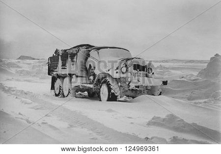 CHUKCHI PENINSULA USSR - APRIL 12, 1982: Expeditionary truck covered with snow in tundra in Chukchi Peninsula at April 12, 1982
