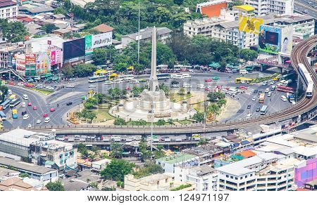 Bangkok Thailand - April 12 2014: Victory Monument Bangkok's major traffic intersections military monument erected in June 1941 to commemorate the Thai victory in the Franco-Thai War.