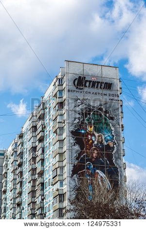 Moscow, Russia - April 04.2016. Advertising Avengers from Marvel comics on the facade of a residential building