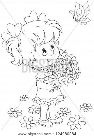 cute little girl with a bouquet of flowers looking at a flying butterfly