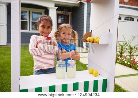 Portrait Of Two Girls Running Homemade Lemonade Stand