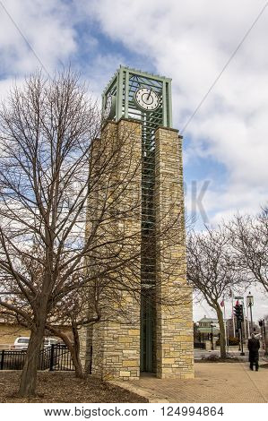 Photograph of a picturesque clock tower in a midwestern city.