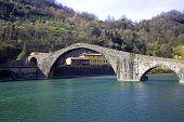 Magdalene bridge (also named Devil's bridge) over Serchio river in Tuscany Italy poster