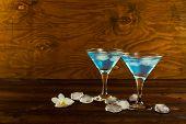 Blue curacao liqueur cocktail in a martini glasses. Blue cocktail. Blue margarita. Blue Hawaiian cocktail. Blue curacao liqueur. Blue Martini poster